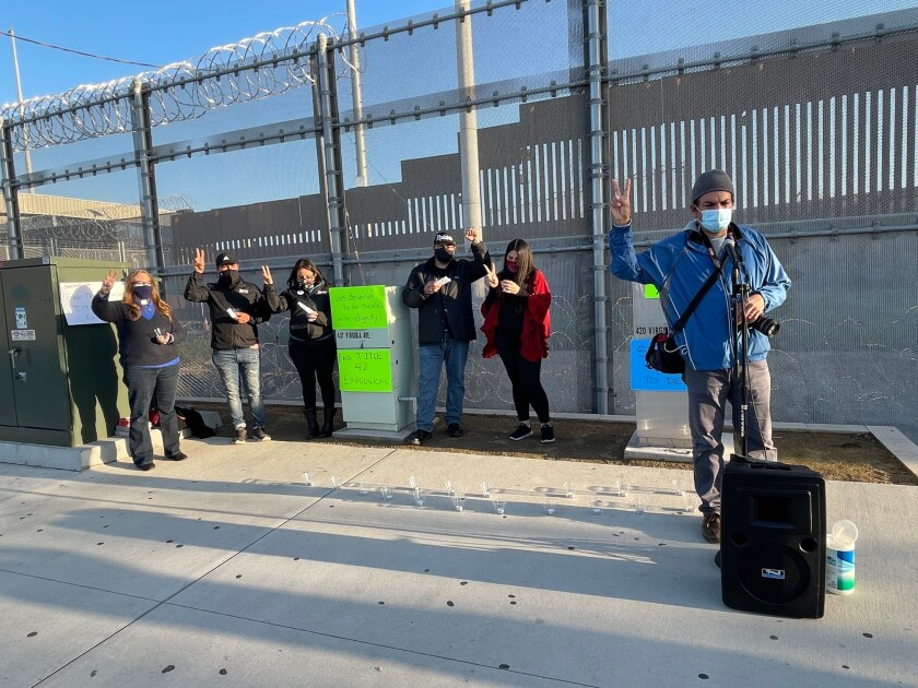 A group of activists holds a vigil outside the PedWest crossing in San Ysidro in honor of deceased immigrants.