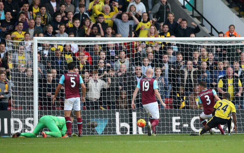 Watford's Odion Ighalo scores their first goal of the game during their English Premier League soccer match against West Ham at Vicarage Road, London, Saturday, Oct. 31, 2015. (Scott Heavey/PA via AP)     UNITED KINGDOM OUT     -     NO SALES     -    NO ARCHIVES
