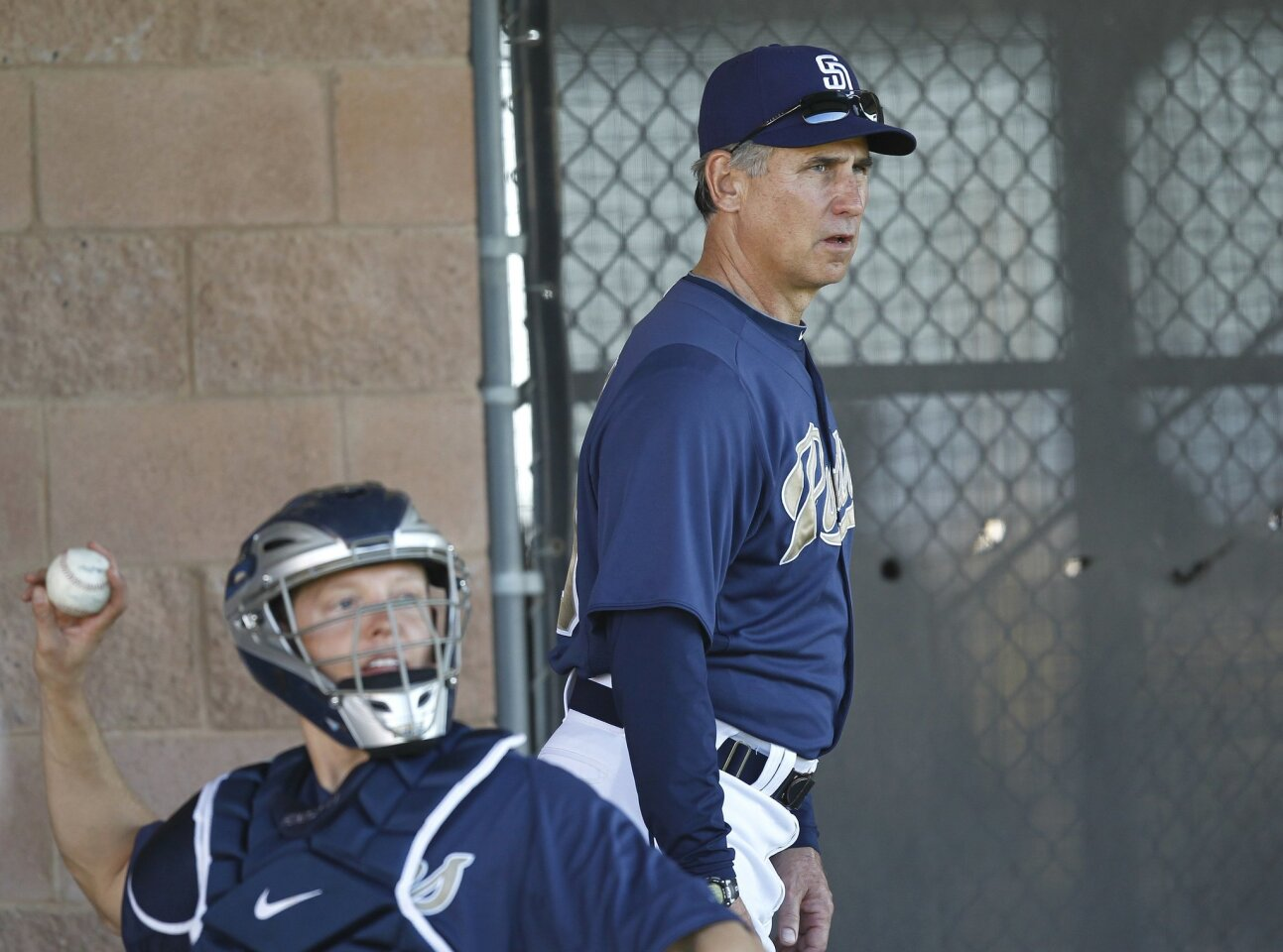Padres manager Bub Black watches his pitchers during the San Diego Padres spring training.