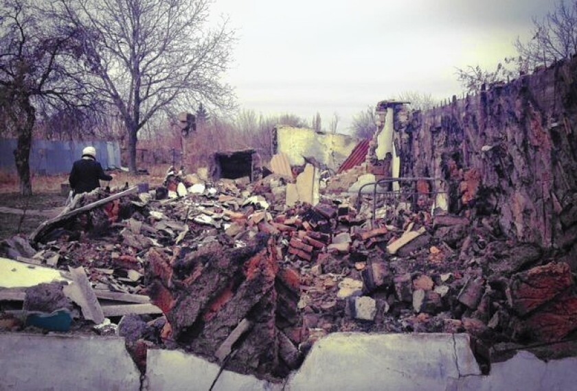 An artillery shell that ripped through her home in eastern Ukraine in mid-August left Luda Nesterenko, left, with rubble. In a split second, her life savings were reduced to its foundation.