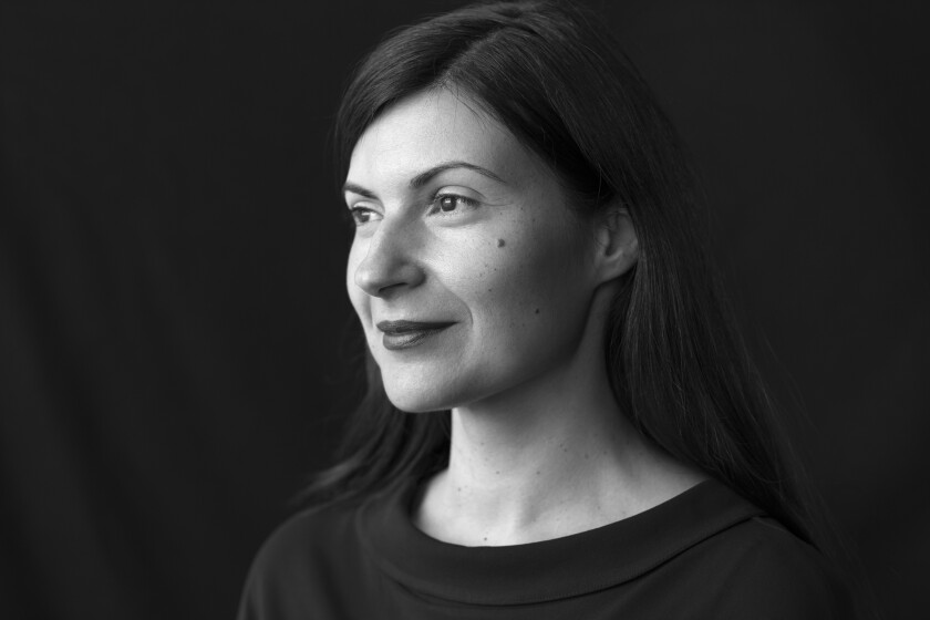 A black-and-white portrait of author Mona Awad.