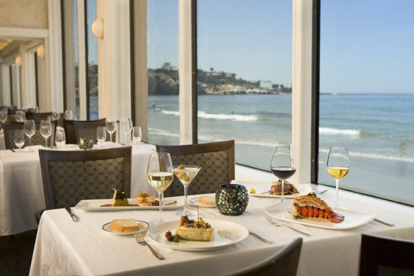 The Marine Room is located on La Jolla Shores beach and offers guests panoramic views of the ocean directly outside the dining room.