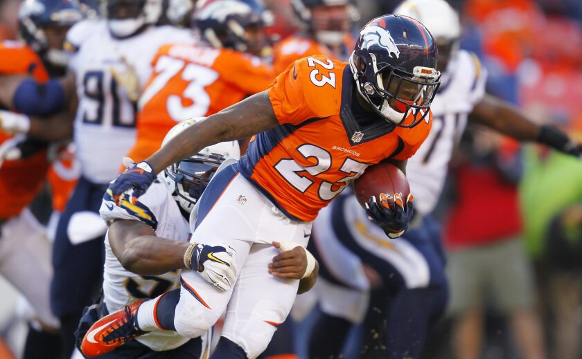 Chargers Denzel Perryman tackles Broncos Ronnie Hillman for a loss in the 2nd quarter.