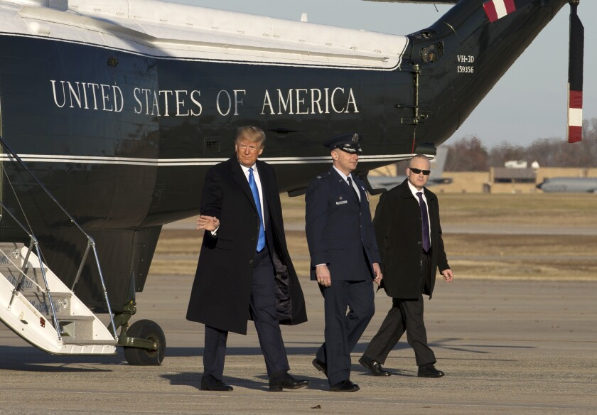 President Donald Trump steps off Marine One upon arrival at Andrews Air Force Base, Md., Saturday, Dec. 7, 2019, en route to Florida to attend a Republican fundraiser and speak at the Israeli American Council National Summit. ( AP Photo/Jose Luis Magana)