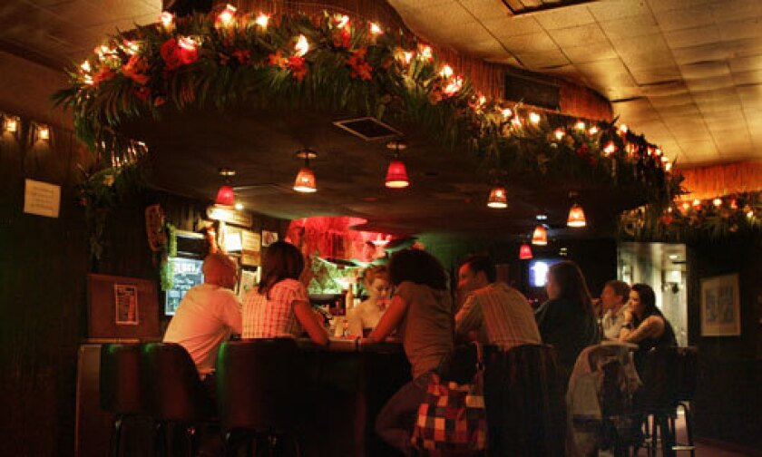 ISLAND FEVER: Loyal patrons fill the bar at the colorful yet little-known Tonga Hut, which has been restored to its 1960s glory by current owners Ana Reyes and Jeremy Fleener.