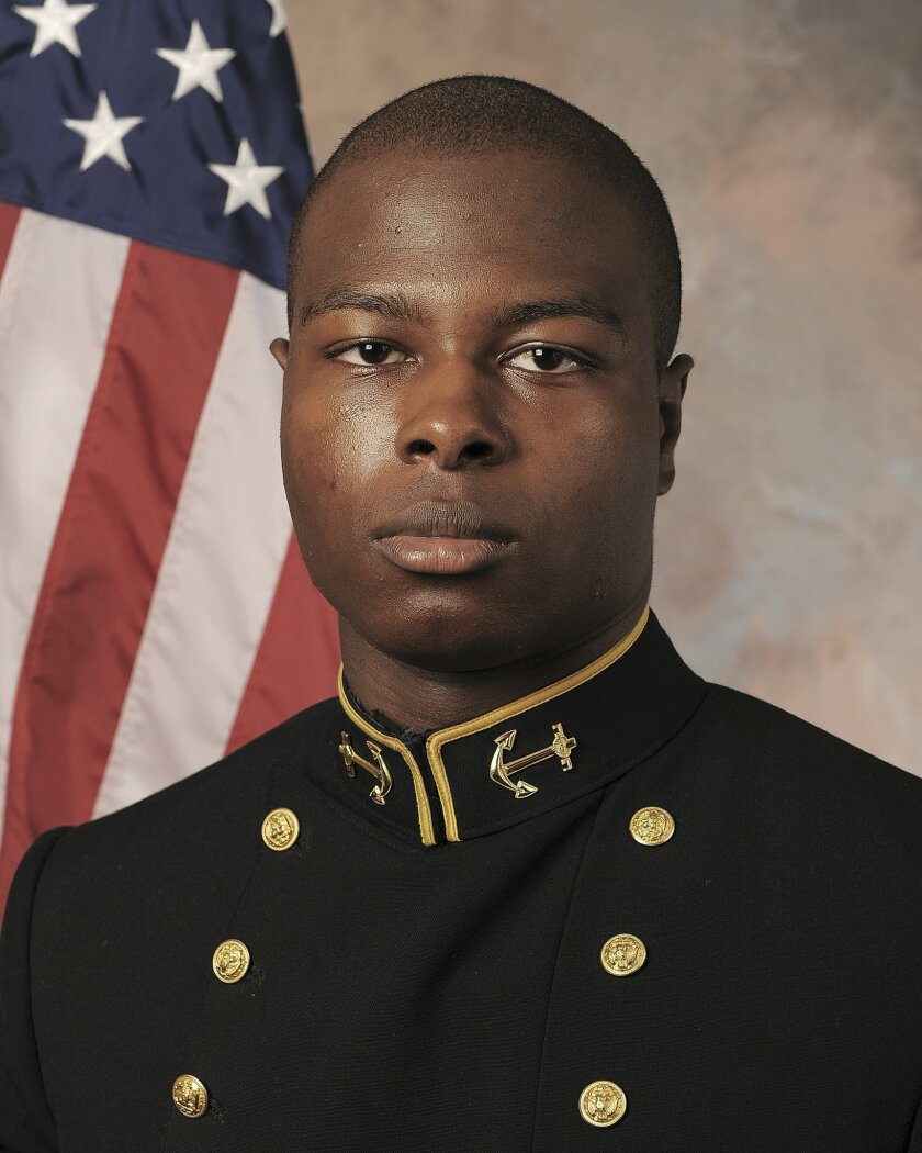 In this July, 24, 2013 photo released by the U.S. Navy Football team, Midshipman Eric Graham is shown. A lawyer for Graham, one of two U.S. Naval Academy midshipmen charged in a sexual assault case, says he was advised today by prosecutors, that all charges against his client are being dropped. The academy couldn't immediately confirm charges have been dropped. (AP Photo/U.S. Navy Football)