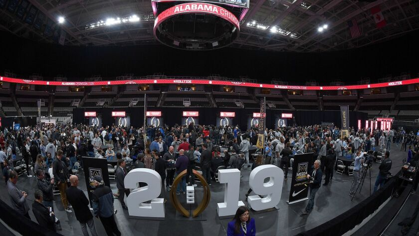 Coaches and players of the Alabama Crimson Tide are interviewed in SAP Center in San Jose during media day for the College Football Playoff championship game.