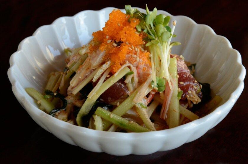 Sunomono Salad combines raw seafood and cucumber with rice vinegar at Samurai Japanese Restaurant in Solana Beach.