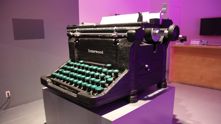 Youd creates sculptures of the typewriters different novelists have worked on — such as this cardboard rendering of the Underwood Rechy used.