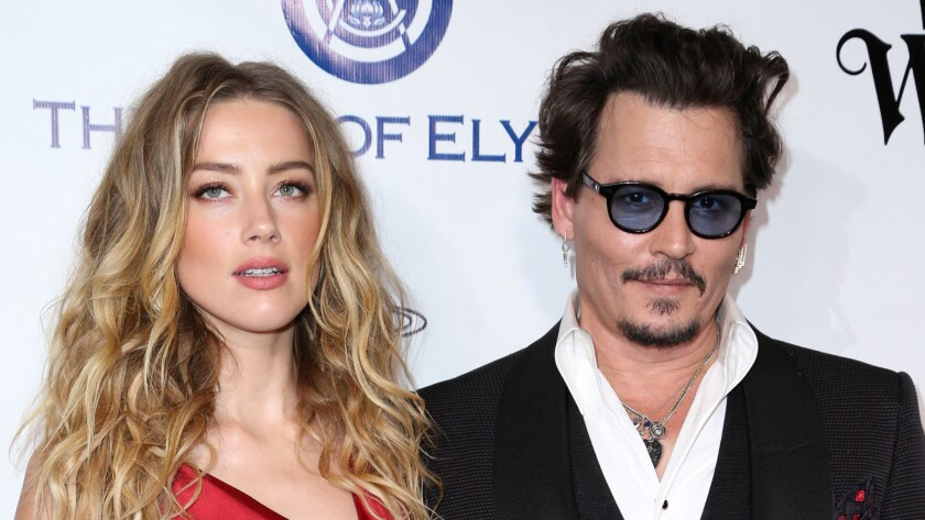 Amber Heard and Johnny Depp are seen together in January 2016.