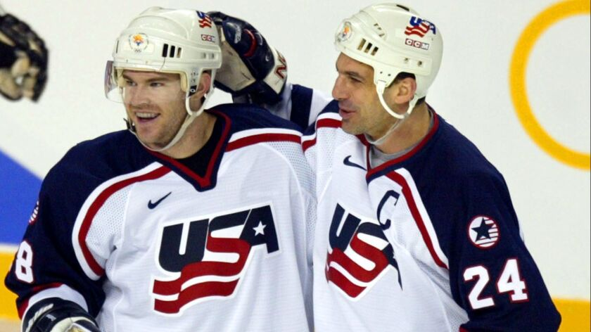 Scott Young, left, and Chris Chelios of the U.S. celebtate Young's third-period goal against Belarus at the 2002 Salt Lake City Olympics.