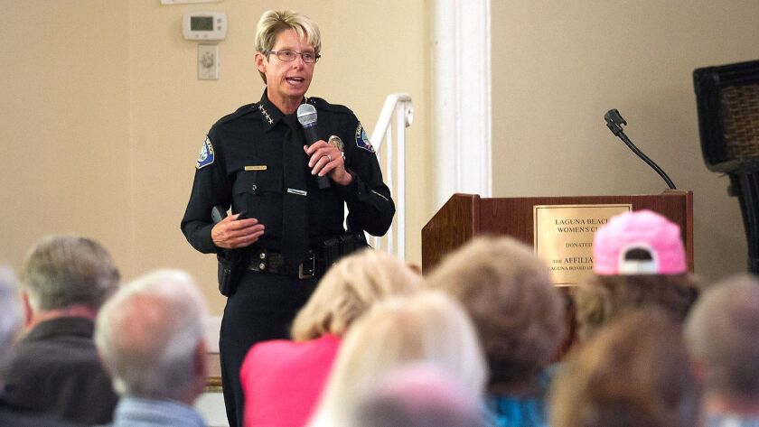 Laguna Beach Police Chief Laura Farinella, shares some of the 2015-16 crime data with guests, during