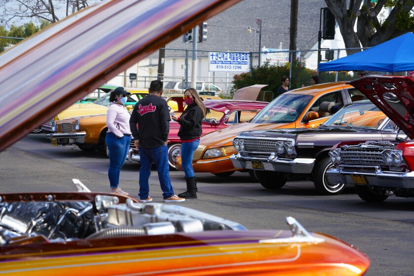 The United Lowriders Coalition joined National City's 100-day COVID vaccination placing several low riders on display.