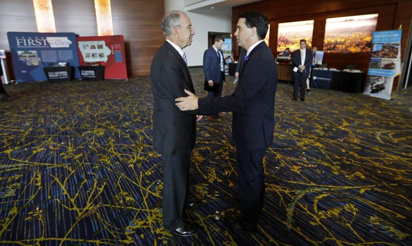 U.S. Sen. Chuck Grassley, R-Iowa, talks with Wisconsin Gov. Scott Walker, right, during the National Governors Association meeting, Friday, July 15, 2016, in Des Moines, Iowa. (AP Photo/Charlie Neibergall)