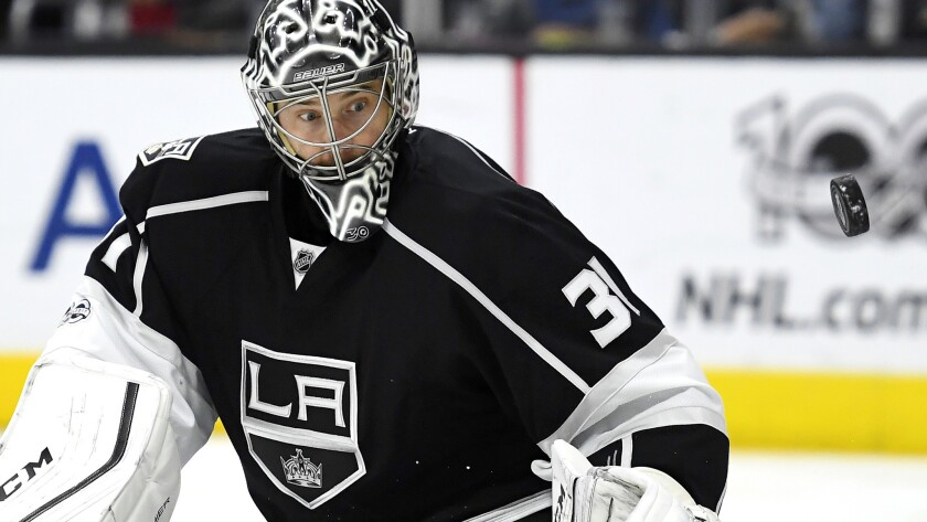 Kings goalie Ben Bishop watches the puck after defecting it during the third period against the Winn
