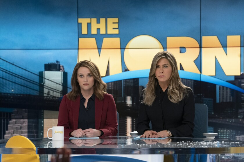 """At the anchor table, tension is high between Bradley (Reese Witherspoon), left, and Alex (Jennifer Aniston) in """"The Morning Show."""""""