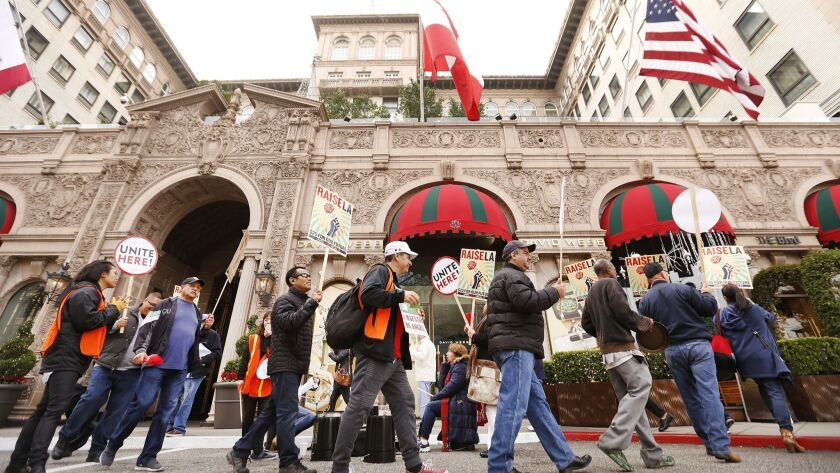 Hotel workers from Unite Here Local 11 demonstrate in front of the Beverly Wilshire on Wednesday.