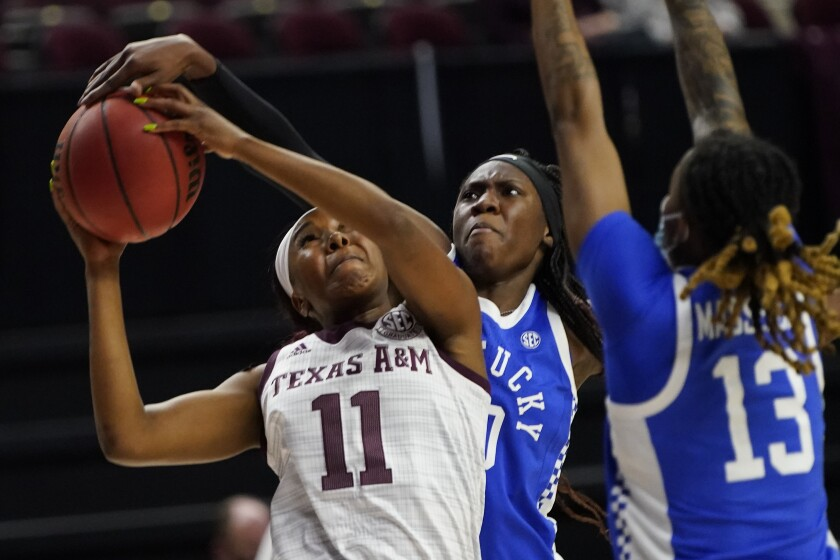 Kentucky guard Rhyne Howard (10) blocks a shot-attempt by Texas A&M guard Kayla Wells (11) during the second half of an NCAA college basketball game Thursday, Jan. 7, 2021, in College Station, Texas. (AP Photo/Sam Craft)
