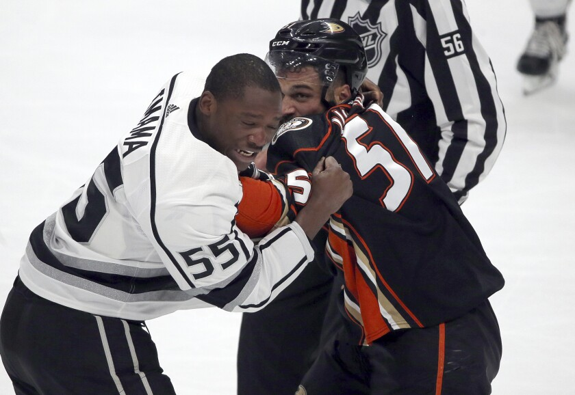Kings forward Boko Imama, left, and fights Ducks left winger Mike Liambas fight during a preseason game in September 2017.