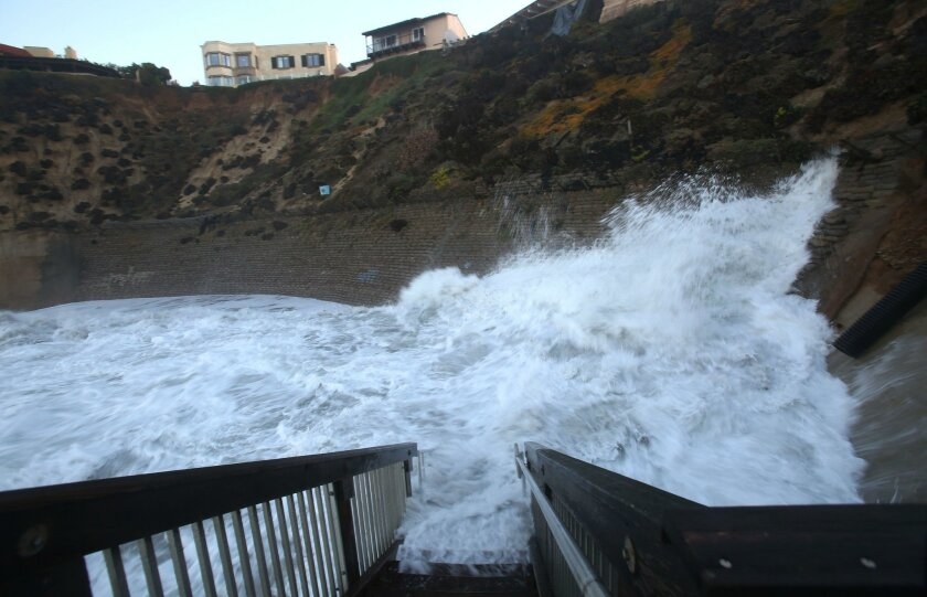 Solana Beach, CA. January 7, 2016 |   High tide and big surf slammed into the sea cliffs at Tide Park in Solana Beach Friday morning.   | Mandatory photo credit: Peggy Peattie / San Diego Union-Tribune