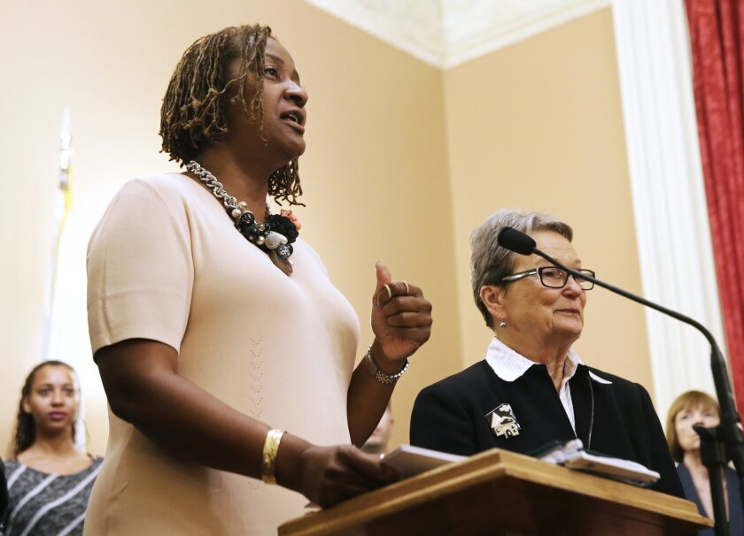 State Sens. Holly Mitchell (D-Los Angeles), left, and Loni Hancock (D-Berkeley) discuss their efforts to change Proposition 13 at a news conference at the Capitol on Wednesday.