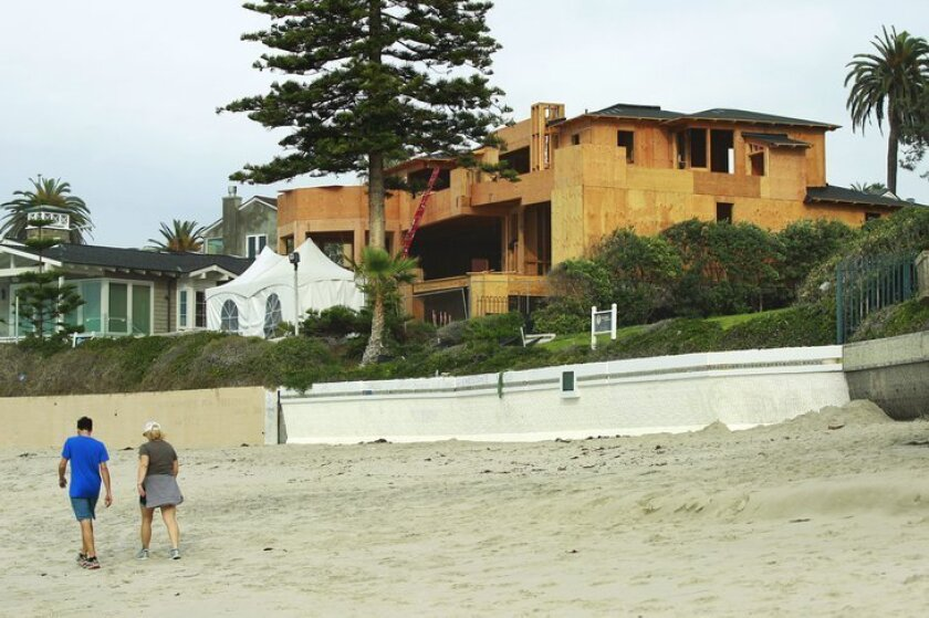 Construction continues on the La Jolla oceanfront home of Mitt Romney. There are reports that he might sell it.