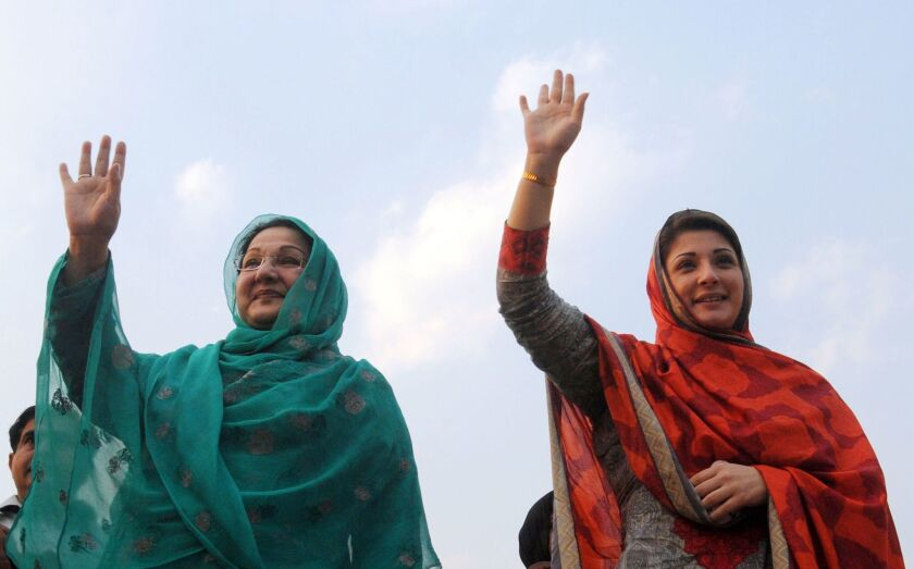 Maryam Safdar, right, and her mother, Kulsoom Nawaz, wave to supporters during an election rally in Lahore in 2013. Safdar, daughter of Pakistani Prime Minister Nawaz Sharif, was named in leaked papers as a trustee or owner of companies based in the British Virgin Islands, a popular tax haven.