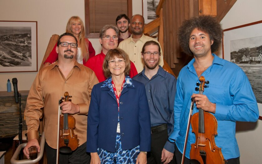 The Hutchins Consort at a performance in Del Mar sponsored by the Del Mar Foundation. Pictured at front with the group is Donna Shaw, chair of the Foundation's Cultural Arts Committee.