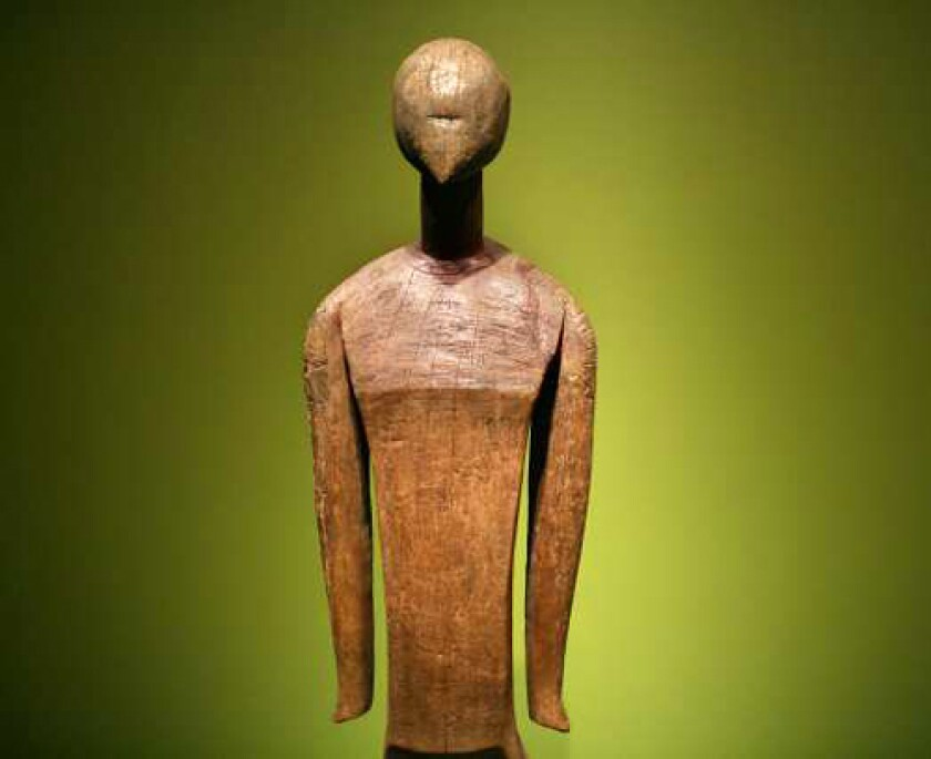 """ON POINT: A sculpture from the Caroline Islands in Micronesia, from early 19th century or before, stands more than 6 feet tall at San Diego Museum of Art's """"Oceanic Art"""" exhibit."""