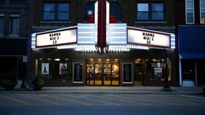 "The marquee is lit up for the 7 p.m. showing of ""Mamma Mia 2"" at the Webster Theater in Webster City, Iowa, on Aug. 18."