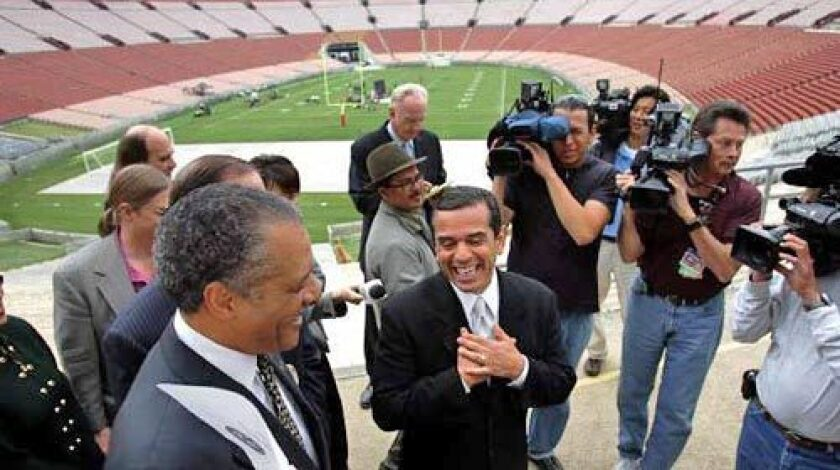 In April of 2006, Mayor Antonio Villaraigosa, center, Councilman Bernard Parks, left, and members of the Coliseum Commission toured the stadium and gave a news conference to discuss a presentation to the National Football League and stadium improvements.