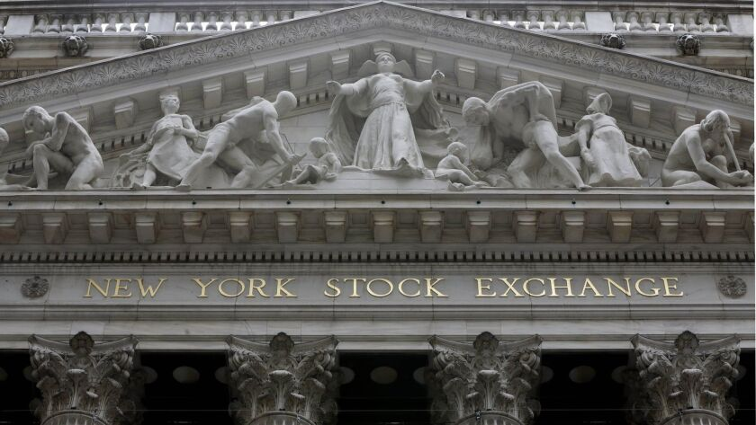 The facade of the New York Stock Exchange is shown.
