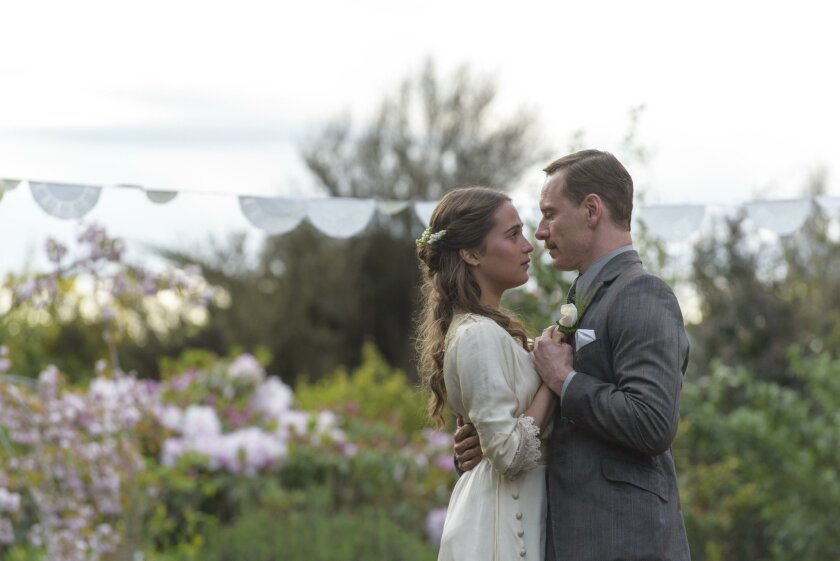 "Michael Fassbender as Tom Sherbourne and Alicia Vikander as his wife, Isabel, in ""The Light Between Oceans."""