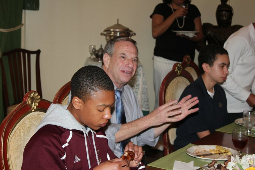 The Bishop's School freshmen Kenan Draughorne (left) and Will Dyer (right) share lunch with Congressman Bob Filner.