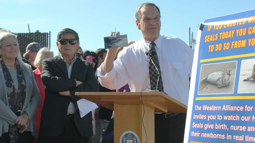 Bob Filner announces the installation of the now-defunct SealCam at Children's Pool beach early last year. His communications director, Irene McCormack Jackson, who has since filed sexual harassment charges against him, is pictured at left. File