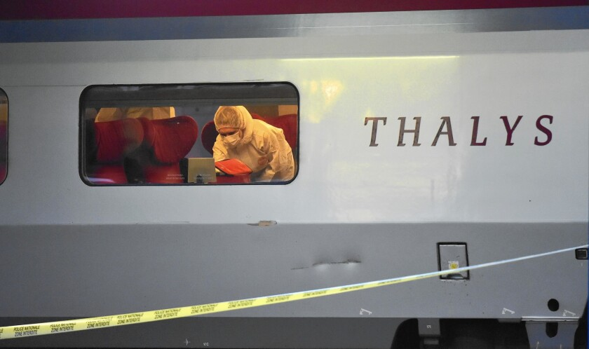 Police inspect a high-speed Thalys train after three Americans thwarted an attack during a trip from Amsterdam to Paris.
