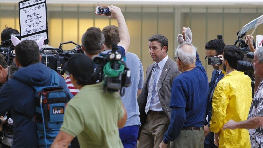 Congressman Duncan Hunter is met with protesters outside a recent San Diego federal court hearing.