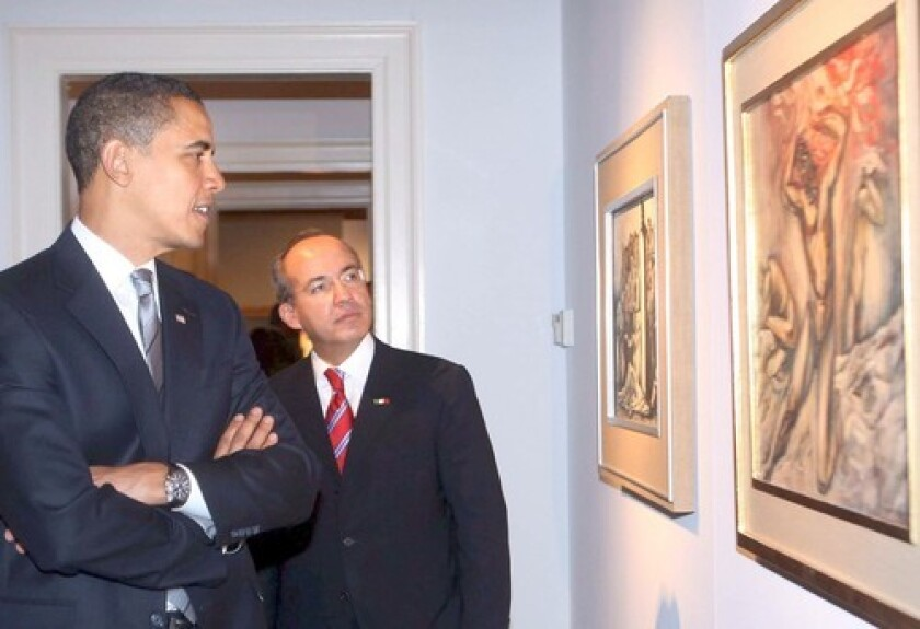 President-elect Barack Obama and Mexico's President Felipe Calderon view paintings during their meeting at the Mexican Cultural Institute in Washington.
