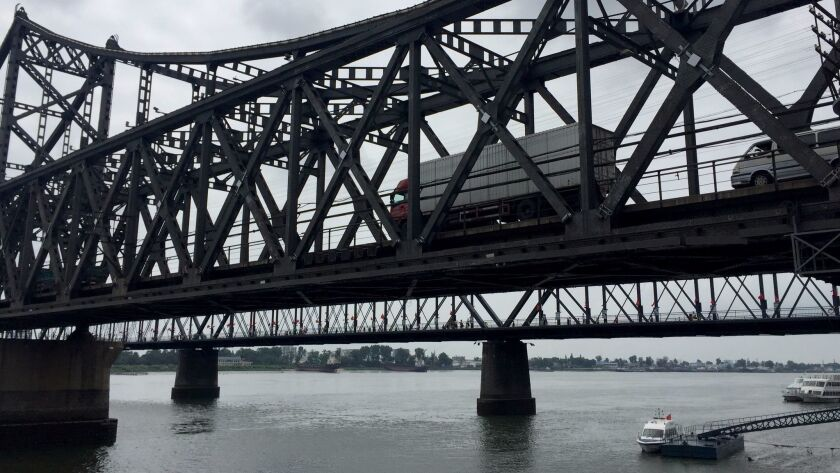 Trucks cross the Sino-Korean Friendship Bridge connecting North Korea and Dandong, China.