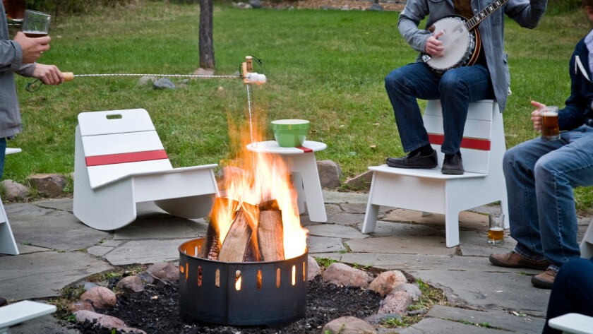 This steel fire ring ($811) from Loll Designs doubles as a cocktail table, courtesy of a recycled plastic top, when not in use.