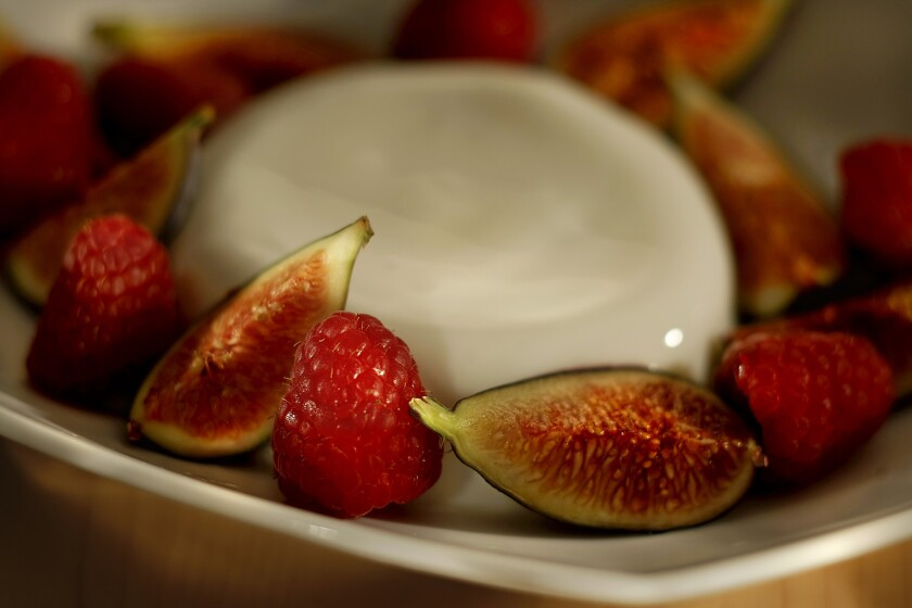 Panna cotta with figs and raspberries.