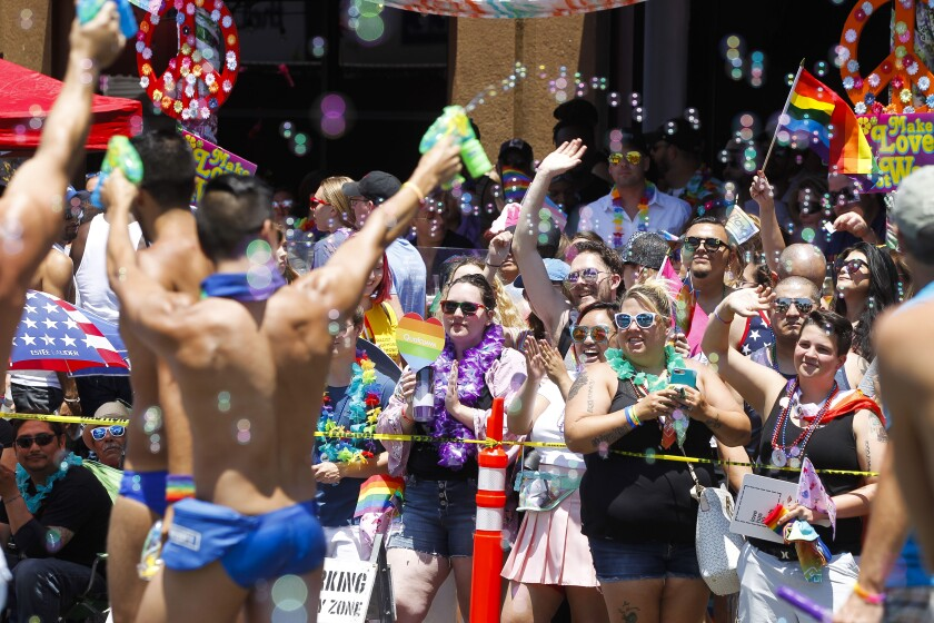 Spectators cheer on parade participants during the San Diego Pride Parade in San Diego in 2018.