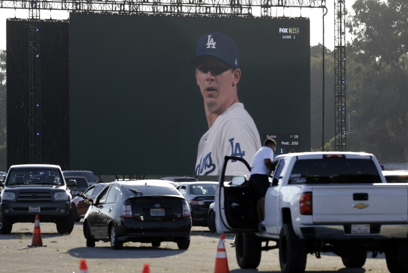 Fans drive into Dodger Stadium to watch the National League Championship Series.