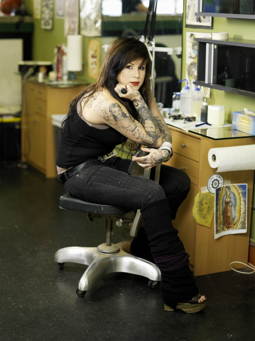 """Kat Von D in a tattoo parlor on """"Miami Ink."""""""