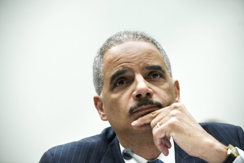 The U.S. Justice Department's inspector general criticized the department's prosecutions of mortgage-fraud cases, a report released Thursday said. It said that during a 2012 press conference, Atty. Gen. Eric H. Holder, above, cited faulty statistics to overstate enforcement actions.