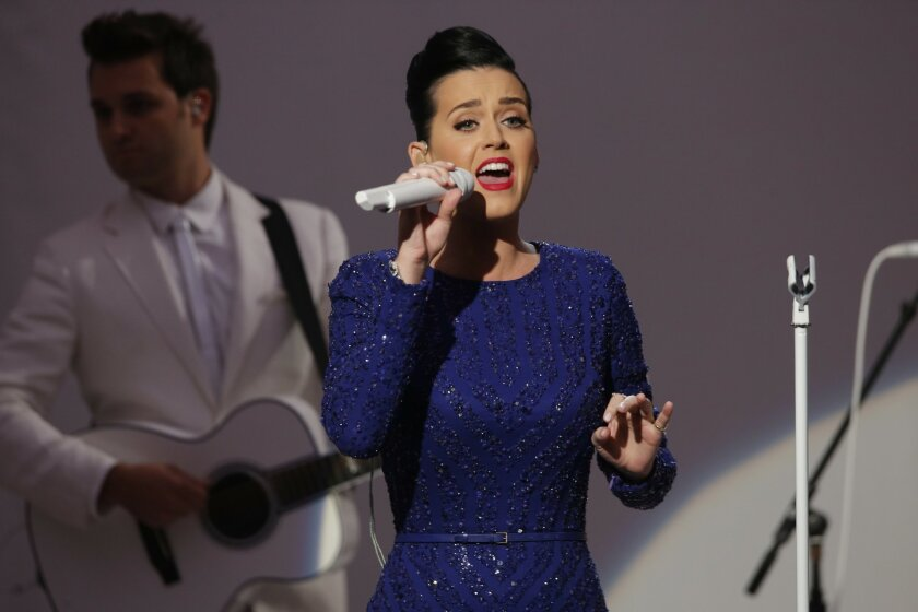 """Singer Katy Perry performs her song """"Roar"""" at an event for the Special Olympics hosted by President Barack Obama in the State Dining Room at the White House in Washington, Thursday, July 31, 2014. (AP Photo/Charles Dharapak)"""