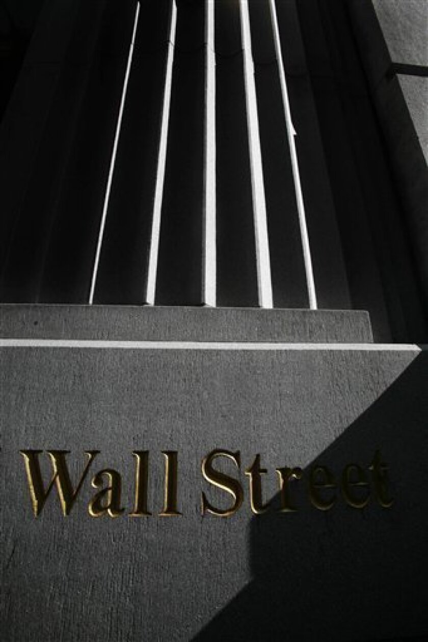A sign for Wall Street is shown, Monday, March 8, 2010 near the New York Stock Exchange. With little in the way of economic reports or earnings Tuesday, March 9, to help drive shares higher, investors are taking a breather after major indexes rose the past few weeks.(AP Photo/Mark Lennihan)