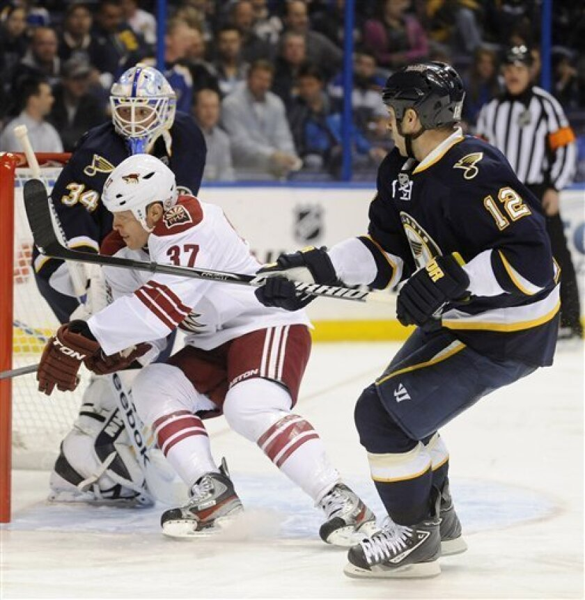 St. Louis Blues' goalie Jake Allen (34) and Scott Nichol (12) defend against Phoenix Coyotes' Raffi Torres (37) in the first period of an NHL hockey game on Thursday, March 14, 2013, in St. Louis. (AP Photo/Bill Boyce)