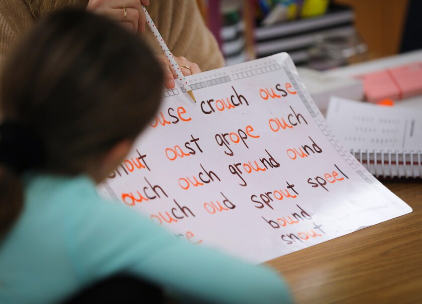 """Sara Valafar, an instructional aide in the resource class at Chaparral Elementary School in Poway, worked with students on word sounds and spelling using the Barton reading program on February 11, 2020. Barton is one of several """"structured literacy"""" approaches used to address dyslexia, a neurological disorder that makes reading difficult."""