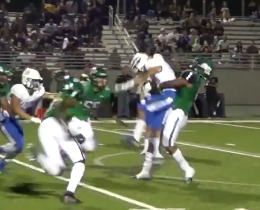 Upland linebacker Justin Flowe sends La Habra's Brandon Vazquez airborne on a tackle on Thursday night that resulted in a 15-yard penalty for unnecessary roughness.